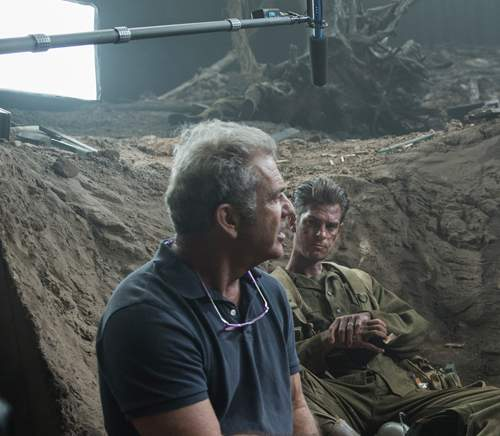 Director Mel Gibson on set with Andrew Garfield, who plays Doss